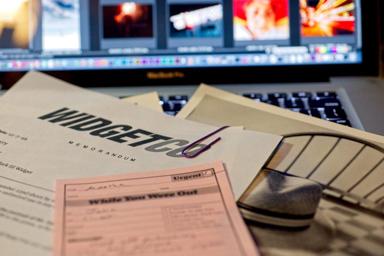 "Paper ""metadata"" displayed on a computer keyboard"